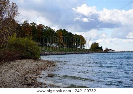 A View Of The Rocky Shoreline Along Little Traverse Bay, In Bay View, Michigan, During October.