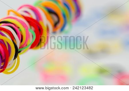 Various Colorful Plastic Tires Are On White Background. Selective Clarity,blurred Background