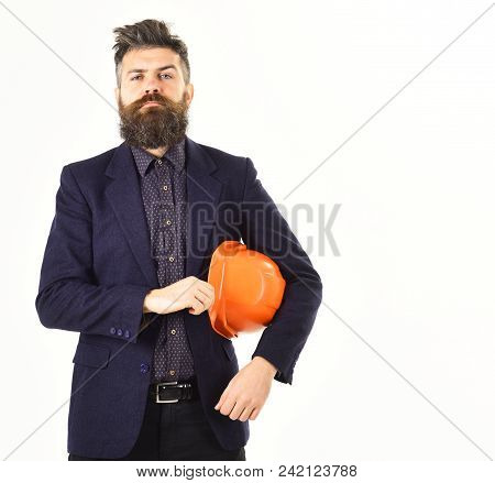 Team Leader Or Construction Manager With Proud Face. Bearded Man Holds Helmet Isolated On White Back