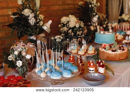 Candy Bar. Delicious sweet buffet with cupcakes. Sweet holiday buffet with cupcakes and other desserts. poster
