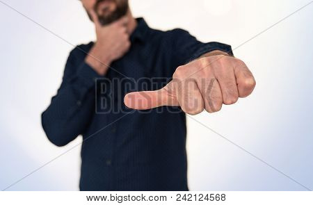 Businessman In Blue Shirt Doing Hand Gesture With Thumb Sideways