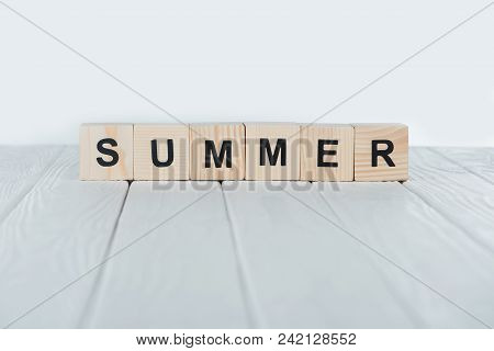 Close Up View Of Summer Inscription Made Of Wooden Cubes On White Wooden Tabletop