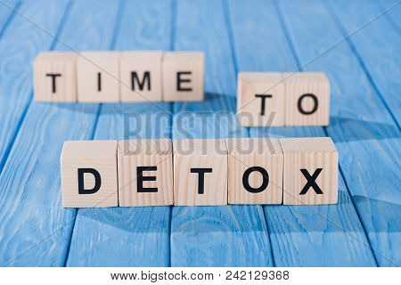 Close Up View Of Arranged Wooden Blocks Into Time To Detox Phrase On Blue Wooden Surface