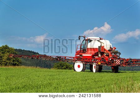 Field Spraying Tractor. Agricultural Work On A Farm In The Czech Republic. Spraying Against Pests