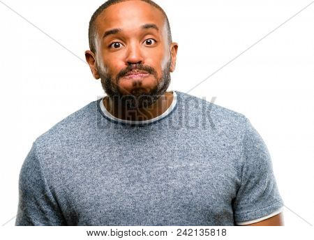African american man with beard puffing out cheeks, having fun making funny face isolated over white background