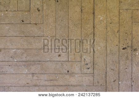 A Close-up Of An Old Faded Parquet Covered With Dust And Dirt. Result Of Repair. Cleaning And Cleani