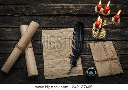 Old Blank Letter Paper Page On The Aged Wooden Background. Manuscript. Back To School Or Poem Writer