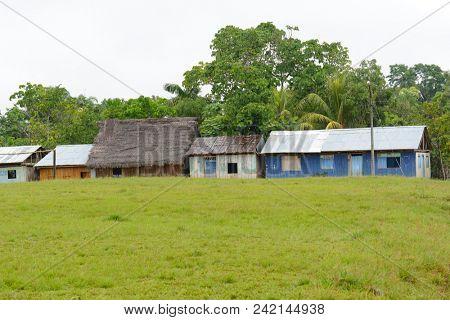 SANTA ANA VILLAGE, PERU - OCTOBER 16, 2015: Buildings in the small village of Santa Ana in the Iquitos area of the Peruvian Amazon.