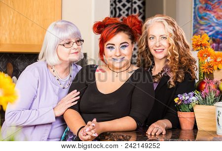 Three Happy Women Standing Together In The Kitchen