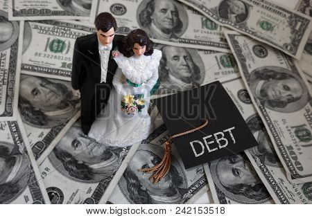 Newly Married Millennial Couple On Cash With Student Debt Graduation Cap