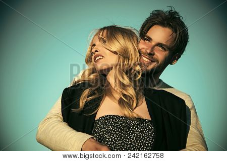 Sensual Young Couple Making Love In Bedroom. Couple In Love On Blue Sky Background. Love And Romance