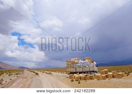 Lost Truck Load, The Load Spilled Across The Gravel Road In The High Andes Mountains Of Northern Chi