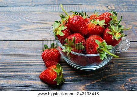 Fresh Ripe Strawberries In A Bowl On A Wooden Table. Freshly Harvested Crop.