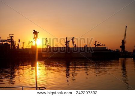 Magnificent Sunset Over The Sea In Port Silhouettes Of Ships