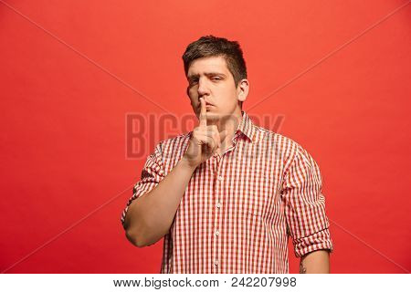 Secret, Gossip Concept. Young Man Whispering A Secret Behind His Hand. Businessman Isolated On Trend