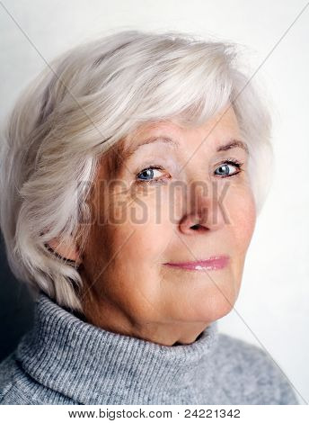 Senior woman portrait with grey pullover