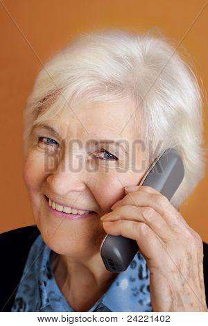 Senior lady with telephone