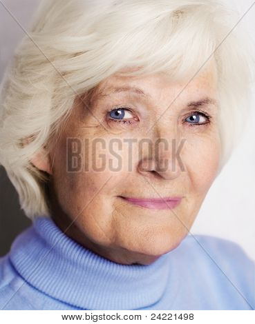 Senior lady portrait with blue pullover