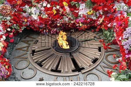Flowers At The Monument Of Eternal Glory At The Tomb Of The Unknown Soldier. Inscription To The Unkn