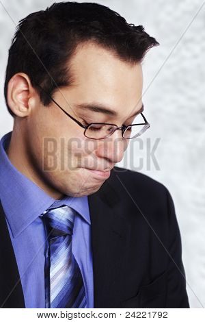 Attractive business  man with disappointed face