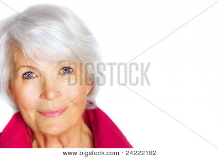 Portrait of a graciously senior woman with white hair and pink blouse on white background