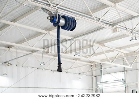 The Device For Removing Exhaust Gases In The Car Repair Shop. Car Service Equipment. Ventilation. Ve
