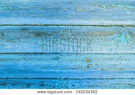 Texture Wooden Background With Planks Covered With Old Peeling Paint Of Blue Color. Closeup Of Peeli