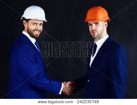 Business People Handshake. Partners With Beards And Happy Faces. Entrepreneur And Architect Made Dea