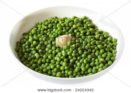 Peas with butter, in white serving bowl.