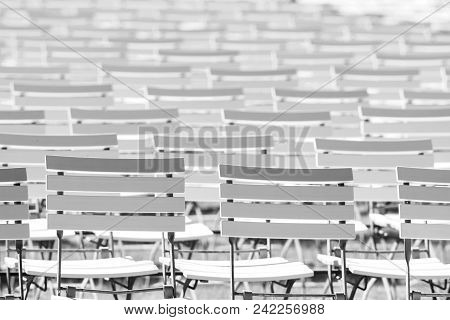 White Chair Rows In A Spa Park In Black And White