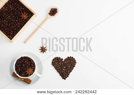 Cup Of Coffee Seeds, Cinnamon, Anis Coffee Heart Shapes, Wooden Box And Spoon With Coffee    On Whit