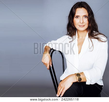 Pretty Brunette Confident Mature Woman Sitting On Chair In Studio, Lifestyle People Concept Close Up