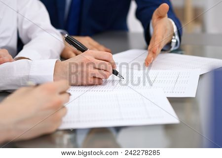 Bookkeepers team or financial inspectors  making report, calculating and checking balance. Tax service financial document. Audit or meeting concept. poster
