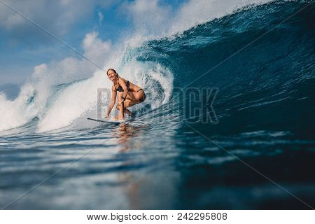 Surf Woman At Surfboard Ride On Barrel Wave. Woman In Ocean During Surfing, Uluwatu