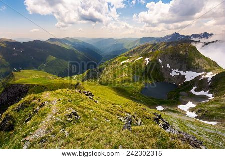 Beautiful Landscape Of Romanian Mountains. Lovely Summer Scenery On A Cloudy Day. Lake Capra Down Th