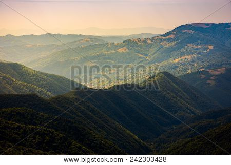Beautiful Rolling Hills Of Carpathian Mountains. Lovely Summer Landscape, Bird Eye View. Village Bru