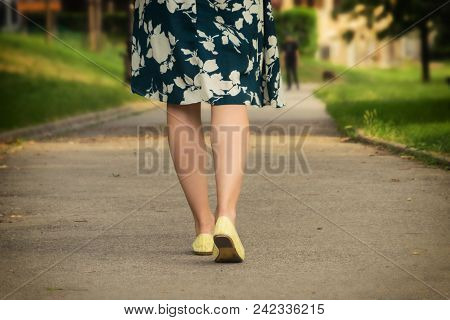 Walk in the Park. Park. Walking. Female legs. Girl Walk in the Park in Yellow Shoes. Girl Legs Walk Park.