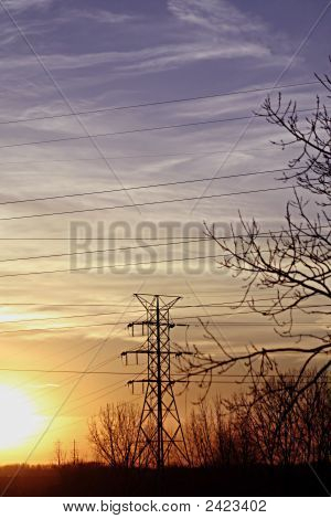 High Powerlines Silhouette at Sunset with Blue and Orange Sky poster