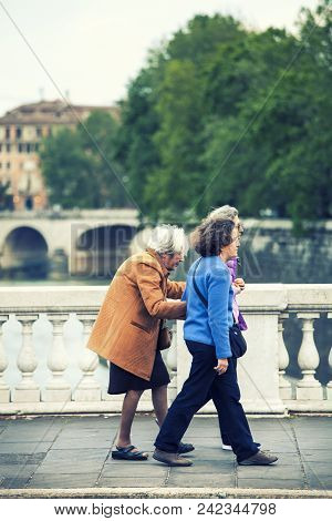 Rome, Italy. May 06, 2015: Three Women In The Street On A Bridge In The Center Of The City Of Rome,