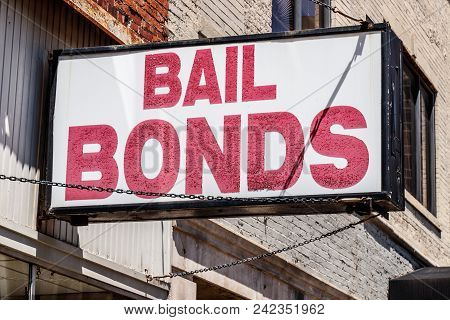 Bail Bonds Sign Chained To A Building I