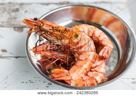 Tiger prawns being grilled with charring on the BBQ