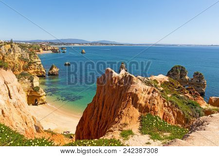 Spectacular Views And Secluded Small Beaches On Algarve Coastline In Portugal. Scenic Cliffs And Gro