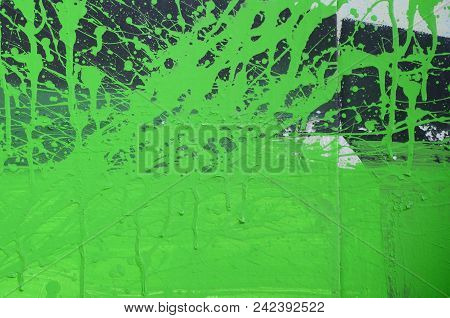 Street Art. Abstract Background Image Of A Fragment Of A Colored Graffiti Painting In Khaki Green An