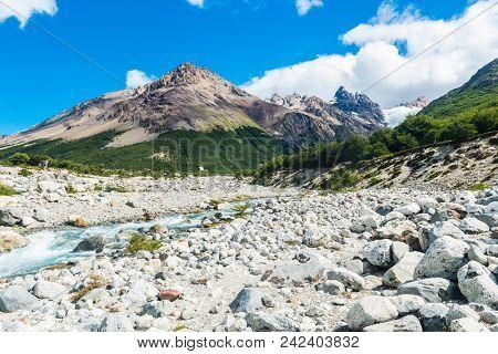 Beautiful swift brook on the track to Glacier Piedras Blancas in Los Glaciares National park, Argentina