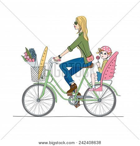 A Girl With A Child On The Bike. Child In A Child Seat With Candy.