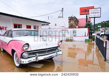 Williams, Arizona - July 24, 2017: Classic Pink Ford Fairlane Crown Victoria Parked In Front The Rou