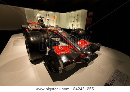 Mclaren Mp4-22 Of F1 With Which Competed Fernando Alonso In Year 2007. Behind, The Equipment He Took