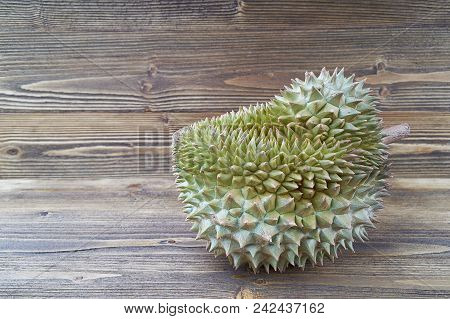 Durio Zibethinus Or Durian On Brown Jane Wooden Texture Background