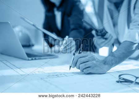 Image Of Engineer Meeting For Architectural Project, Working With Partner And Engineering Tools On W