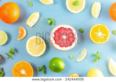 Citrus Slices Food Flat Lay Pattern On Blue Background - Assorted Citrus Fruits With Mint Leaves